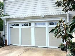 adding the arbor over garage with hardware on doors is easy to do in sing outside