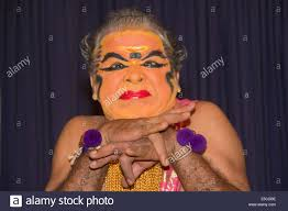 actor in kathakali kerala s clical dance drama wears heavy makeup in this case as a women and uses only hand gestures and