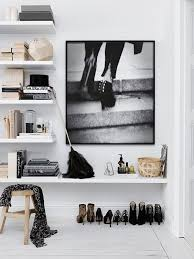 ... how these homeowners combined shoes, books, boxes and objects on the  white shelves. The picture above is from the house I showed yesterday: Raw  Spartan ...