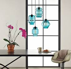 hang several of these beautiful individualistic pendants in a glowing group over the dining table axia modern lighting