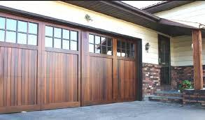 garage door wood lookBrown wood look garage doors with glass window  Home Interiors