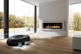 montigo fireplace on white wall plus wooden floor and black stool