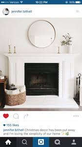 mirror above the fireplace