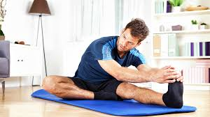 feature man stretching best leg workouts you can do at home leg workouts