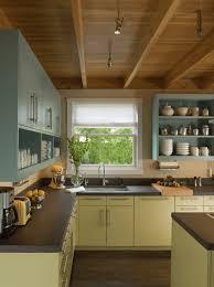 laminate countertops kitchen cabinet painting contractors lighting flooring sink faucet island backsplash mosaic tile stone pine wood grey glass panel door