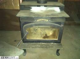 lennox wood stove. this is a certified lennox s210 wood stove. used only for couple years. also comes with hearth and small amount of piping. some discoloration on the stove n