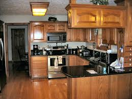 What color laminate flooring with oak cabinets 15 Beautiful Oak Floor Cabinets Wood Floors With Oak Cabinets What Color Hardwood Floor With Oak Cabinets For Kinipela Oak Floor Cabinets Makeupbyroseinfo