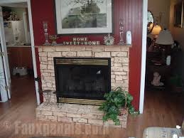 fireplace design with a touch of light colored faux stone can help to brighten up an