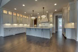lighting a room. clean lines and interesting detail give this kitchen lighting a decidedly sophisticated vibe using iron room