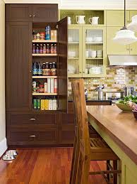 Traditional kitchen pantry designs - Example of a classic medium tone wood  floor kitchen pantry design