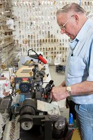 locksmith working. Download Side View Of Locksmith Working In Key Store Stock Image - Clothing,