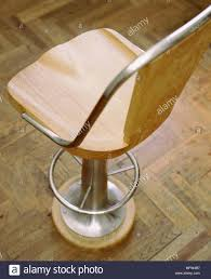 A Detail Of A Wood And Steel Fixed Bar Stool Wooden Parquet