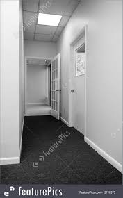 office hallway. Interior Architecture: Looking Down Office Building Hallway Towards Tiled  Entry.