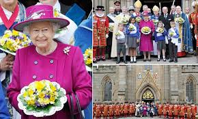 The Queen is jaunty in cerise cashmere as she doles out ... via Relatably.com