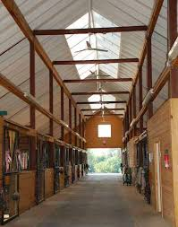 soaring ceilings and 28 skylights highlight the light and airy main barn each 12 x 12 stall has a dutch door to the outside with sliding yoke gates on
