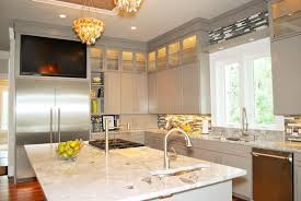 kitchen island close up. in this cozy high contrast kitchen, we see light grey cabinetry over hardwood flooring, kitchen island close up b