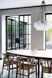 modern dining e with wishbone chairs and a chandelier gl panel dolls as dividers