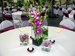 decoration for table. Interior. Round Table With White Tablecloth Combined By Purple Flower On Rectangular Glass Vase And Decoration For F