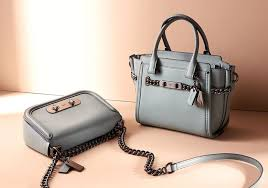 based on designs from coach archives the 27 is slightly smaller than the original crafted in coach glovetanned leather with a detachable shoulder strap