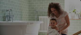 mom and a baby with tankless hot water heater