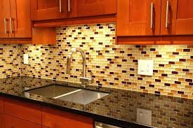 glass tiles for kitchen backsplashes a glass tile with accents of gold and red glass tile