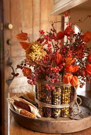 DIY Autumn decor for fall/Thanksgiving: Indian Corn Vase (wrapping a can  with rubber bands, adding corn, twine). More detailed info here.