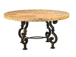 top dining table thick metal is hand forged into a base for round stone outdoor furniture