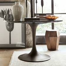 tulip pedestal round dining table aged bronze base
