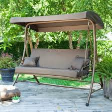 dark brown metal patio swing with grey canopy and seat completed by swings