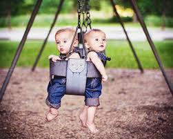 stock photo swinging twins babies swings summertime swing set