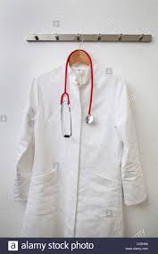 Hanging A Coat Rack Lab coat and stethoscope hanging on a coat rack Stock Photo 90