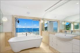 sliding bathroom mirror: modern style beach inspired bathroom design with large wall mirror and mounted lighting plus sliding door with sea wallpaper theme ideas