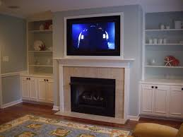gas fireplace ideas with tv above subway tile staircase