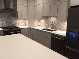 arctic white quartz countertops on white cabinets