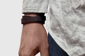 the wrist ruler is a leather bracelet that you wear in a double loop with a shiny metal post for securing tightly on your arm