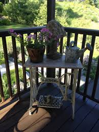 Antique Singer Sewing Machine table with old painted Watering Can ...