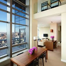 Our Duplex Penthouse Suite Features Two Bedrooms Located On Two Floors With  An Outdoor Terrace Offering Beautiful Views Of New York City.