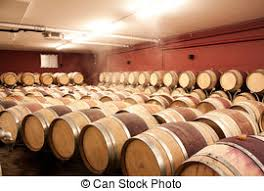 stacked oak barrels maturing red wine. Wine Barrels In Cellar. Cavernous Cellar With Stacked Oak For Maturing Red