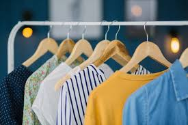 clothes hang on wooden coat hangers in clothing with home tone ping and spending