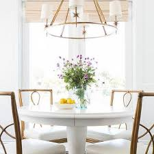 white round dining table with bamboo dining chairs