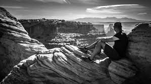 Image result for man sitting in rock