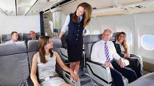 flight attendant quietly informs first class passengers where real flight attendant quietly informs first class passengers where real emergency exits are