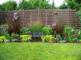 Image of Green Garden Grass featured Wooden Fences underneath Pretty Garden  Flowers for Appealing Design Ideas