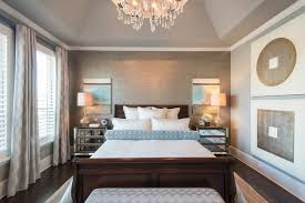 Exquisite Contemporary Bedroom White Trim Ceiling Decoratively Vaulted Tray  Ceiling, White Baseboard Trim With End Table Set Paired Dark Wood Bed Frame.