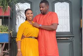 Actor, John Dumelo romantically cuddles his wife in new photo