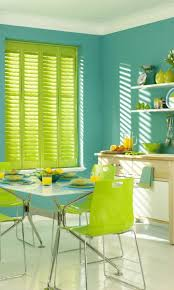 Be bold with bright shades of green and turquoise to create a eye-catching  tropical