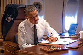 aboard air force one en route to alabama president obama signs hr 432 authorizing the air force 1 office