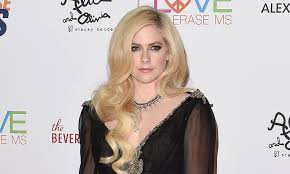 avril lavigne hits first red carpet in two years and talks powerful new al
