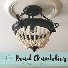 enough as i sit here ready to reveal my latest diy project i am beyond excited to share how i transformed an old light into a bead chandelier