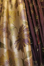 rich deep purple and gold with bold purple and lilac fl prints